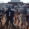 27 Nov 97--Lowell--Players, including Lowell #85 Craig Archambeault, #5 Jason Houston and #70 Thomas Thornton, and Lawrence #1 Victor Torres, shake hands after final Lowell-Lawrence Thanksgiving Day game. Sun Photo Malakie Color Neg #8677.