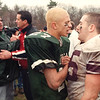 Billerica football 11 25 99 l to r Billerica`s T.J. Canada and Chelmsford`s Dan Warshafsky congratulate each other after a hard fought game. On the left, Coach Flynn and coach Rich do the same. colorphoto by michael pigeon neg#4618