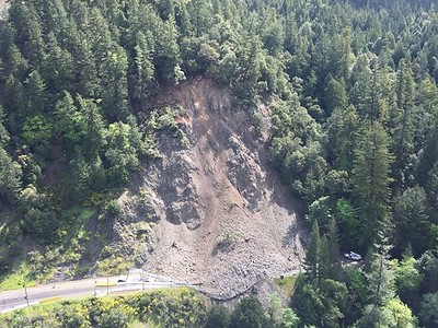 As of Monday, the landslide had broken through a retaining fence. (Photo from Caltrans)