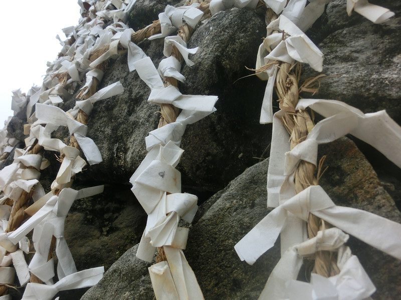 Wishes on paper attached to a gian boulder at the Korean Folk Village