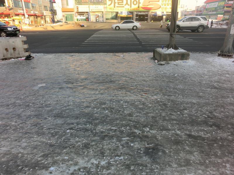 Sidewalk covered in ice in Korea