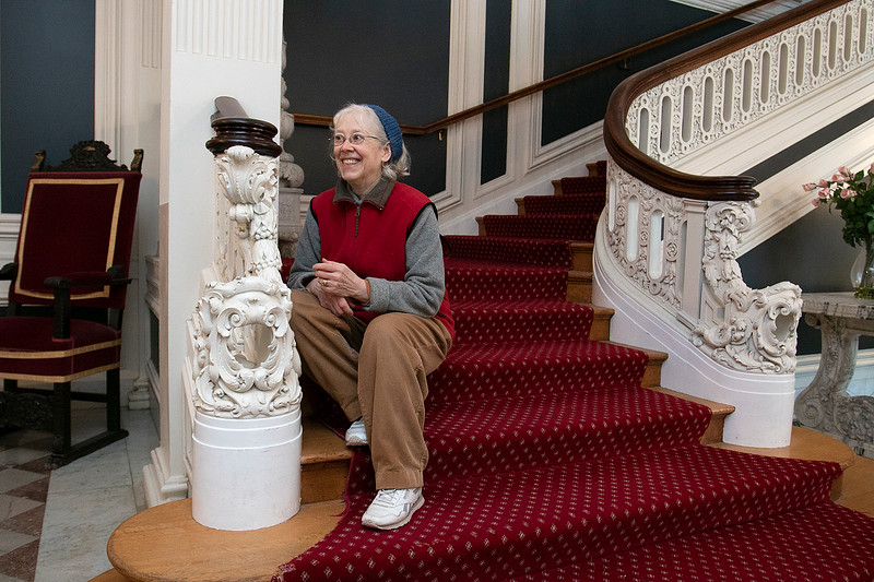 """The Thayer Mansion in Lancaster was used recently in the new movie """"Little Women"""" that came out in 2019. Martha Colby sits on the stairs where one of the actors sat for a scene. She is one of the caretakers of the house and land that lives in the house. SENTINEL & ENTERPRISE/JOHN LOVE"""