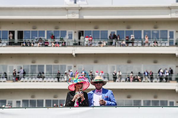 A couple stands above the infield with the Churchill suites in the background during the 143rd Kentucky Derby at Churchill Downs on Saturday. Staff Photo By Josh Hicks