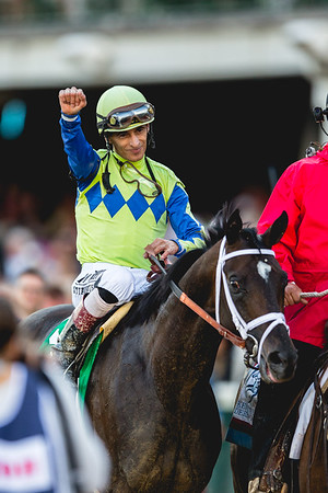 Jockey John Velasquez raises a fist after winning the 143rd Kentucky Derby. Staff Photo By Josh Hicks