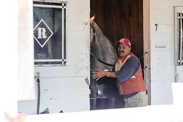 A stablehand cleans a stall at Churchill Downs on Saturday. Staff Photo By Josh Hicks