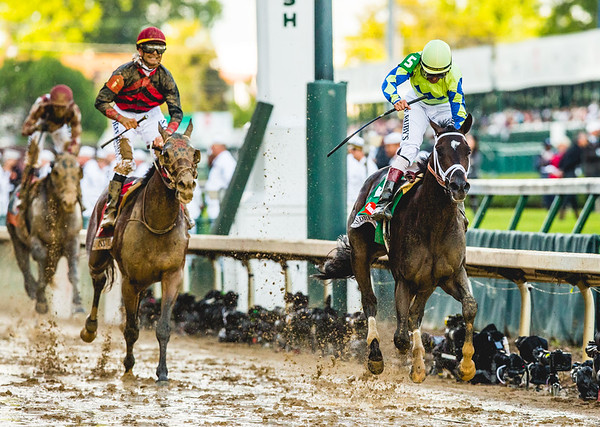 Always Dreaming storms through the muddy finish line, with jockey John Velasquez, winning the 143rd Kentucky Derby on Saturday.  Photo By Josh Hicks/CNHI/News And Tribune