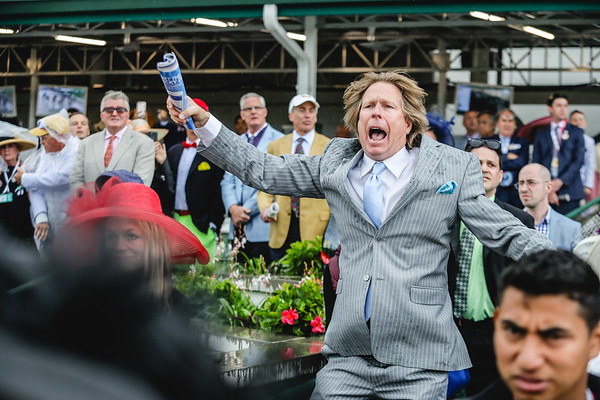 A fan jumps up and down during The 83rd Running of The Churchill Downs (grade II) at the 143rd Kentucky Derby at Churchill Downs on Saturday. Staff Photo By Josh Hicks