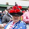 A man, wearing a rose and horse covered hat, laughs for the camera during the 143rd Kentucky Derby at Churchill Downs on Saturday. Staff Photo By Josh Hicks