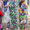 Fans with bright suits walk through Gate 1 for the 143rd Kentucky Derby at Churchill Downs on Saturday. Staff Photo By Josh Hicks