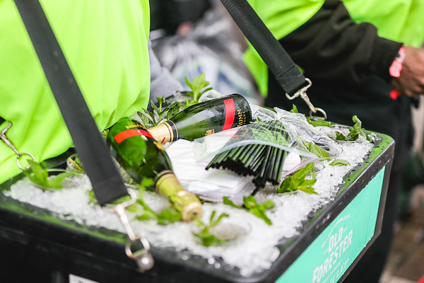 Champagne and Mint Juleps sit in a tray of ice for the 143rd Kentucky Derby at Churchill Downs on Saturday. Staff Photo By Josh Hicks
