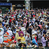 Derby  fans flood the paddock after the rain passes during the 143rd Kentucky Derby at Churchill Downs on Saturday. Staff Photo By Josh Hicks