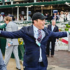 Ben Colebrook, trainer of Limousine Liberal, rejoices after the horse's track record-breaking performance in Race 2 on Toyota Blue Grass Day at the 143rd Kentucky Derby on Saturday. Staff Photo By Josh Hicks