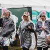 Fans wear ponchos for a rainy first half of the 143rd Kentucky Derby at Churchill Downs on Saturday. Staff Photo By Josh Hicks