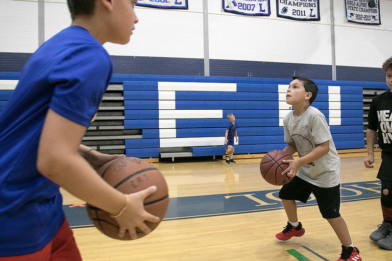 The 16th Mark Osowski Memorial Basketball Camp was being held this week at the Leominster High School gym. Andrew Ferrera, 9, gets ready to put up a free throw during the camp on Tuesday, August 13, 2019. SENTINEL & ENTERPRISE/JOHN LOVE