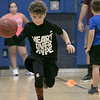The 16th Mark Osowski Memorial Basketball Camp was being held this week at the Leominster High School gym. August 13, 2019. The kids participated in a relay race during the camp. Jayden Rainey, 9, dribbles down court during the relay. SENTINEL & ENTERPRISE/JOHN LOVE