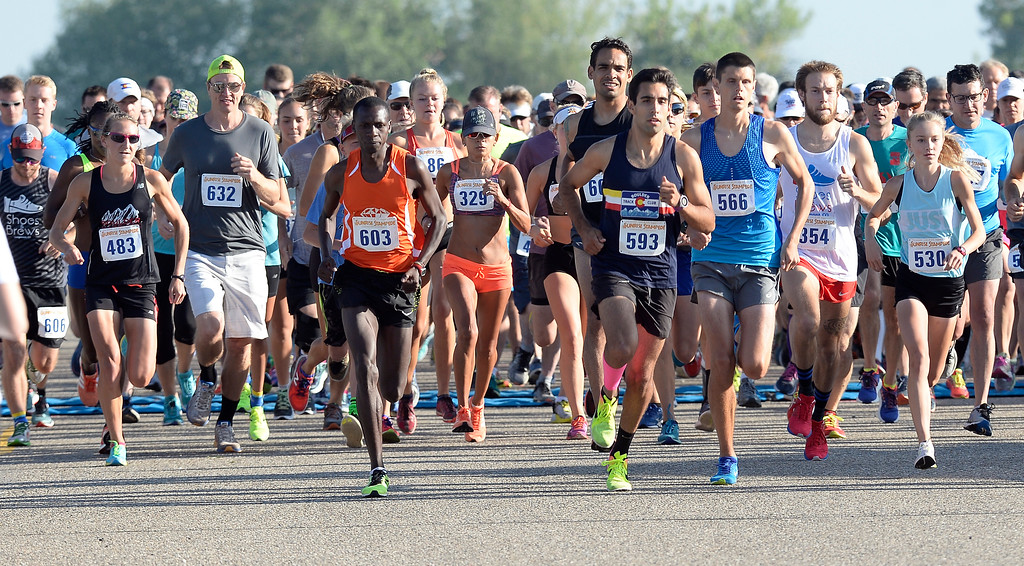 . The start of the 10K of  the annual Sunrise Stampede 2-mile and 10K  races held at Silver Creek High School in Longmont.  For more photos, go to dailycamera.com.  Cliff Grassmick  Staff Photographer August 12, 2017