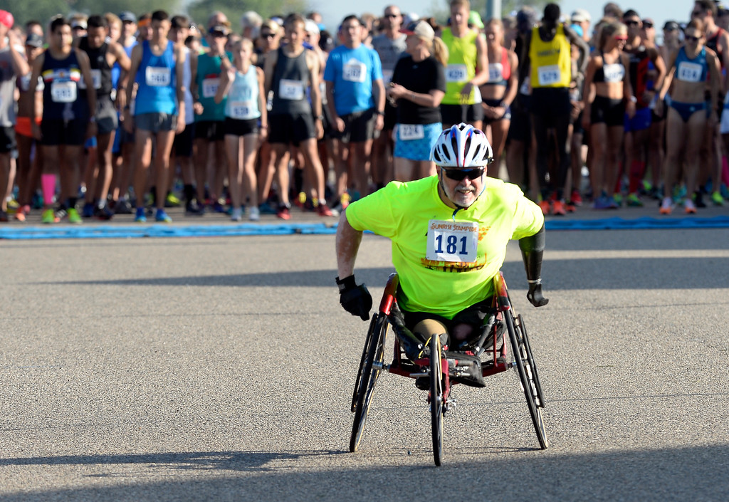. Dennis Gordon begins the wheelchair race of the annual Sunrise Stampede 2-mile and 10K  races held at Silver Creek High School in Longmont.  For more photos, go to dailycamera.com.  Cliff Grassmick  Staff Photographer August 12, 2017