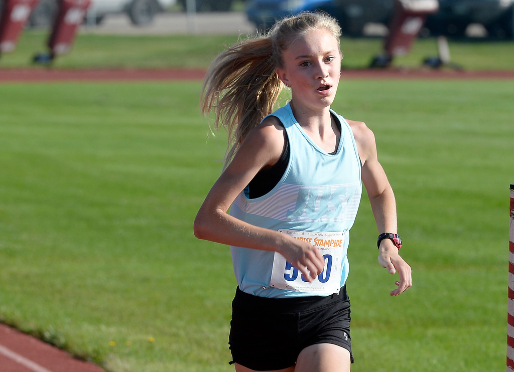 . Sydney Thorvaldson, 14, of Rawlings, WY, was the top female finisher in the 10K of the annual Sunrise Stampede 2-mile and 10K  races held at Silver Creek High School in Longmont.  For more photos, go to dailycamera.com.  Cliff Grassmick  Staff Photographer August 12, 2017