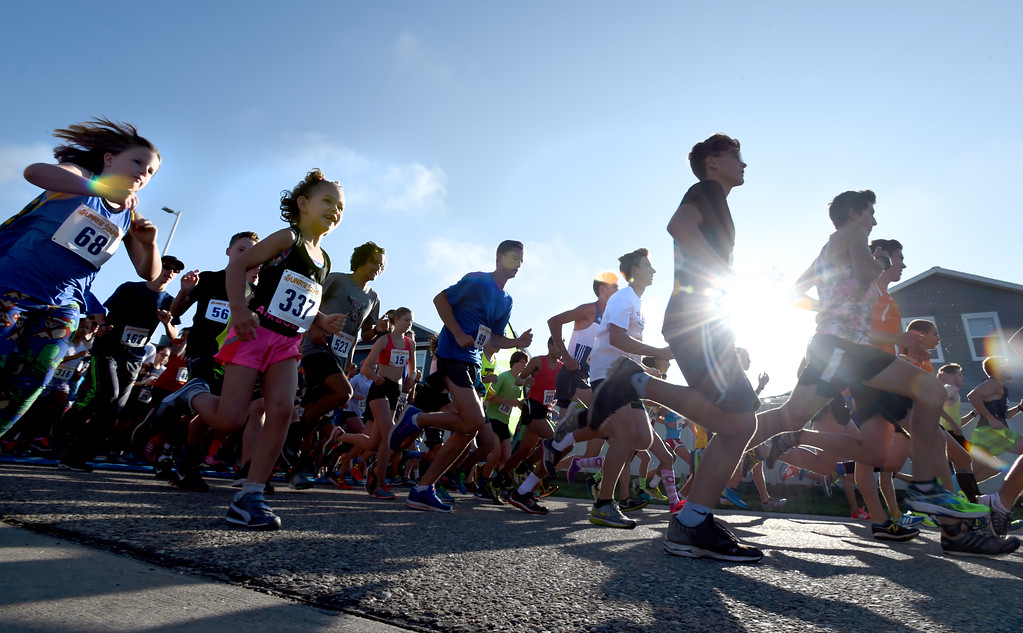. Racers begin the 2-mile race of the annual Sunrise Stampede 2-mile and 10K  races held at Silver Creek High School in Longmont.  For more photos, go to dailycamera.com.  Cliff Grassmick  Staff Photographer August 12, 2017