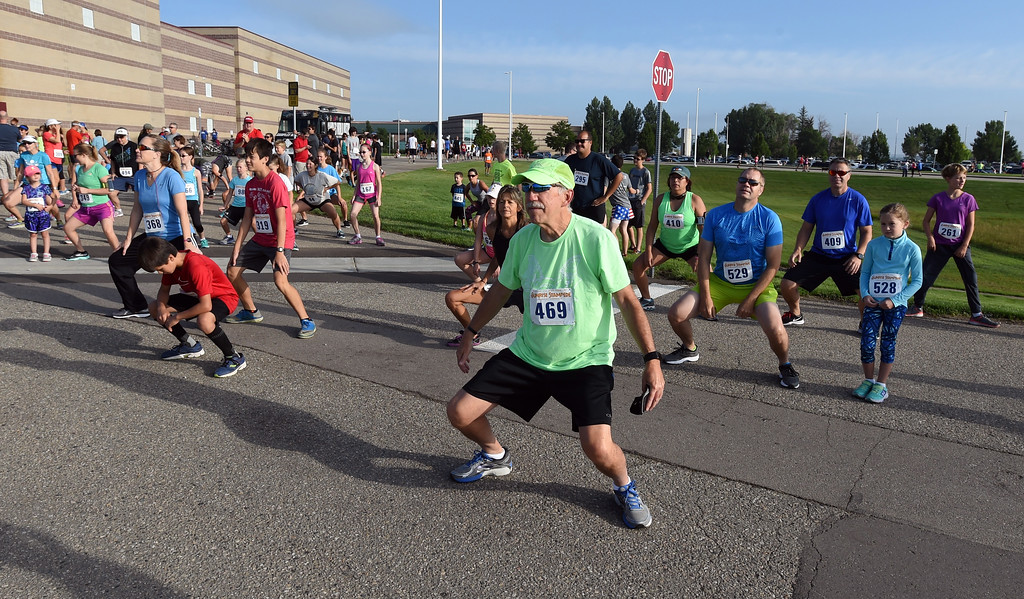 . Runners warm up before  the annual Sunrise Stampede 2-mile and 10K  races held at Silver Creek High School in Longmont.  For more photos, go to dailycamera.com.  Cliff Grassmick  Staff Photographer August 12, 2017