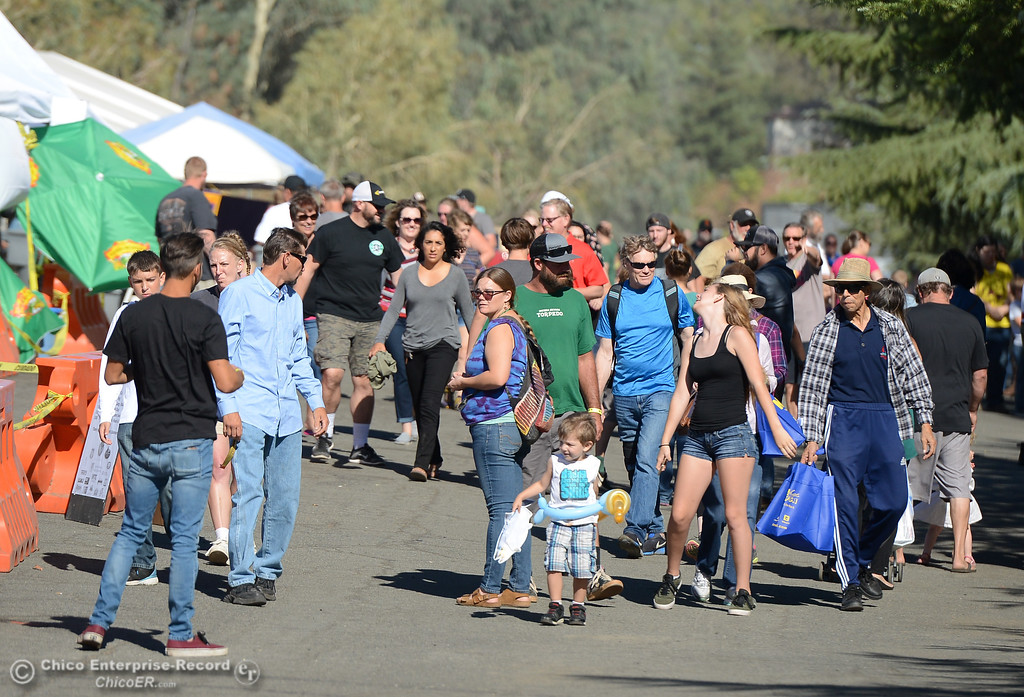 . People enjoy the warm weather and listen to live music during the 23rd Annual Oroville Salmon Festival September 23, 2017 in Oroville, California. (Emily Bertolino -- Mercury Register)