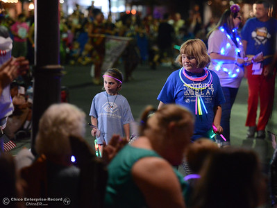Kids from the Boys & Girls Club pass out glow sticks during the 28th annual Chico Parade of Lights  Saturday October 7, 2017 in Chico, California. (Emily Bertolino -- Enterprise-Record)