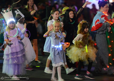Dorothy and her friends from a local girl scoot troop march during the 28th annual Chico Parade of Lights Saturday October 7, 2017 in Chico, California. (Emily Bertolino -- Enterprise-Record)