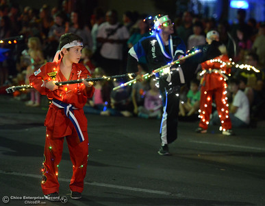 Students from Azad's Martial Arts show off their moves during the 28th annual Chico Parade of Lights Saturday October 7, 2017 in Chico, California. (Emily Bertolino -- Enterprise-Record)