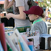 The 29th Annual Ashby Pumpkin Festival & Craft Fair was held on Saturday, September 28, 2019. It was hosted by the Ashby Free Public Library. Looking for a good book at one of the booths at the fair is Lilly Millard, 8, from Leominster. SENTINEL & ENTERPRISE/JOHN LOVE