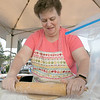 The 29th Annual Ashby Pumpkin Festival & Craft Fair was held on Saturday, September 28, 2019. It was hosted by the Ashby Free Public Library. Rolling out some dough to make apple cider donuts is Pam Peeler of Ashby at the Ashby Congregational Church's booth. SENTINEL & ENTERPRISE/JOHN LOVE