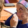 The 29th Annual Ashby Pumpkin Festival & Craft Fair was held on Saturday, September 28, 2019. It was hosted by the Ashby Free Public Library. Getting her face painted like a cat is Delilah Kopsala Paquet, 5, from Greenville New Hampshire at the North Middlesex Regional High Schools booth at the fair. SENTINEL & ENTERPRISE/JOHN LOVE