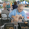 The 29th Annual Ashby Pumpkin Festival & Craft Fair was held on Saturday, September 28, 2019. It was hosted by the Ashby Free Public Library. Frying up some dough to make apple cider donuts is Nancy Peeler of Ashby at the Ashby Congregational Church's booth. SENTINEL & ENTERPRISE/JOHN LOVE