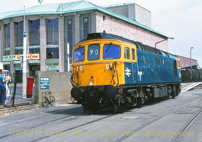Southern Region Class 33 diesel 33104 is seen running round its train at Weymouth Quay on July 20, 1981. As well as passenger trains freight traffic also used the quay tramway and a train of oil tankers can just be seen in the back ground.<br /> <br /> Camera: Contax 139, Carl Zeiss Planar 50mm f1.7 lens. AGFA CT100 film.