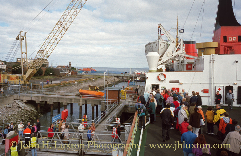 LADY OF MANN loads passengers at Fleetwood on August 10, 1999 for a special sailing to Douglas.