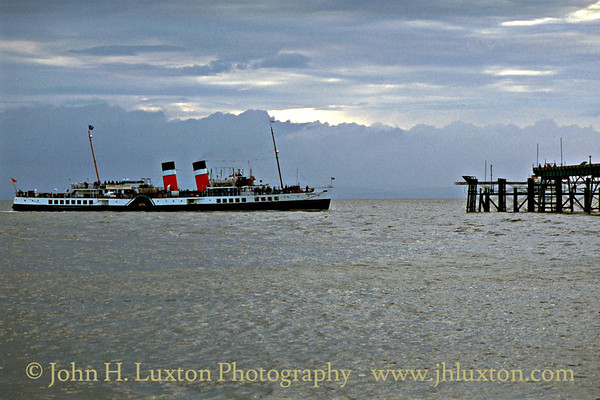PS WAVERLEY goes astern off the berthing head at the still only partially restored Clevedon Pier.