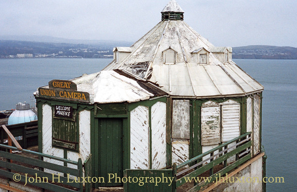 The Grand Union Camera Obscura on Douglas Head was in a very dilapidated state when photographed in February 1996. Fortunately it was rescued by Manx National Heritage and has since been restored as a seasonal attraction. The Camera Obscura is the last surviving of a number of tourist attractions which once traded on Douglas Head.