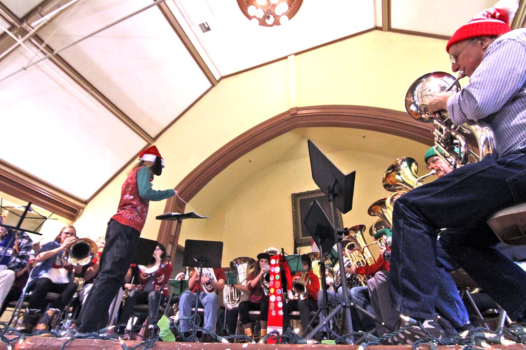 . Conductor for the Tuba Christmas Concert at the Ayer Town Hall, Tom Reynolds, invited young folks to try their hand at conducting, here Jill Valentino 11, of Stow,Ma., gives it a go. SUN/ David H. Brow