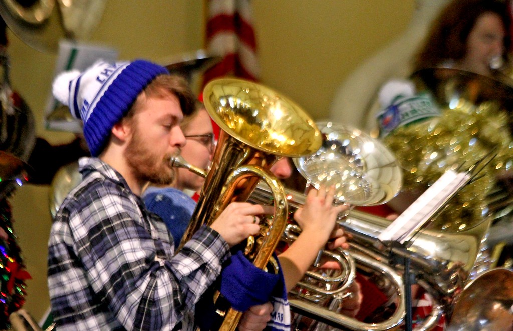 . Playing in the Annual Tuba Christmas Concert at the Ayer Town Hall is Josh Walsh 21, of Chelmsford. SUN/ David H. Brow