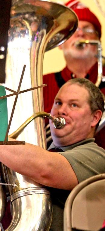 . Rob Morrison of Somerville, on the Tuba for the Annual Tuba Christmas Concert at the Ayer Town Hall. SUN/ David H. Brow