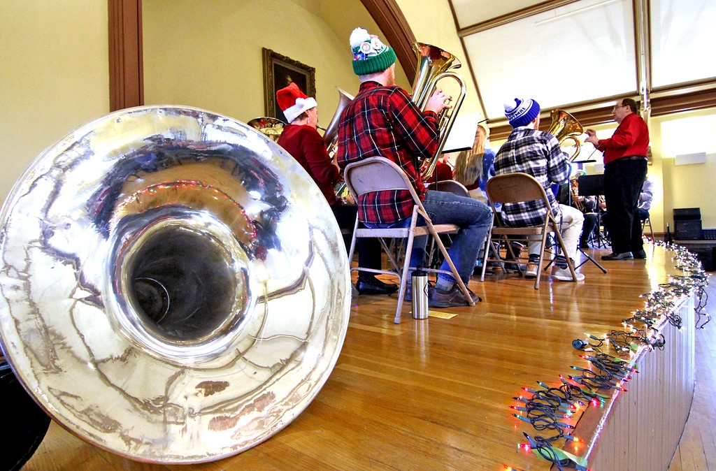 . Conducting the Annual Tuba Christmas Concert at the Ayer Town Hall is Tom Reynolds . SUN/ David H. Brow