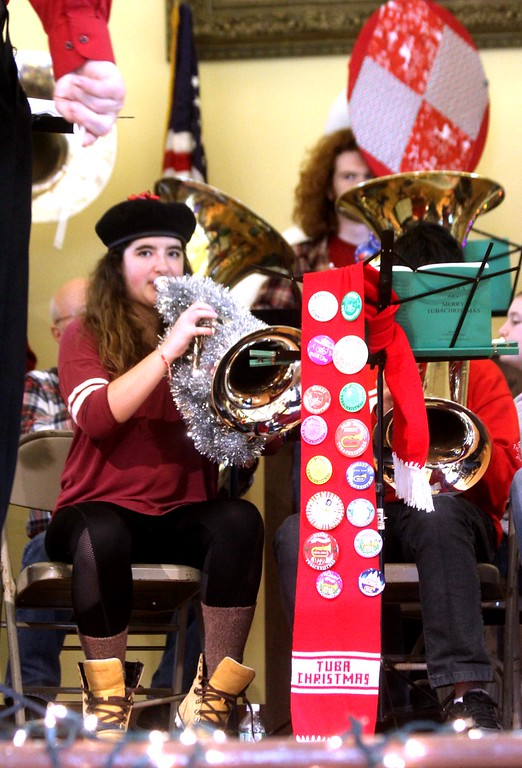 . In middle playing in the Annual Tuba Christmas Concert at the Ayer Town Hall is WPI student Allison Hershoff 19, of Norwell,Ma. SUN/ David H. Brow