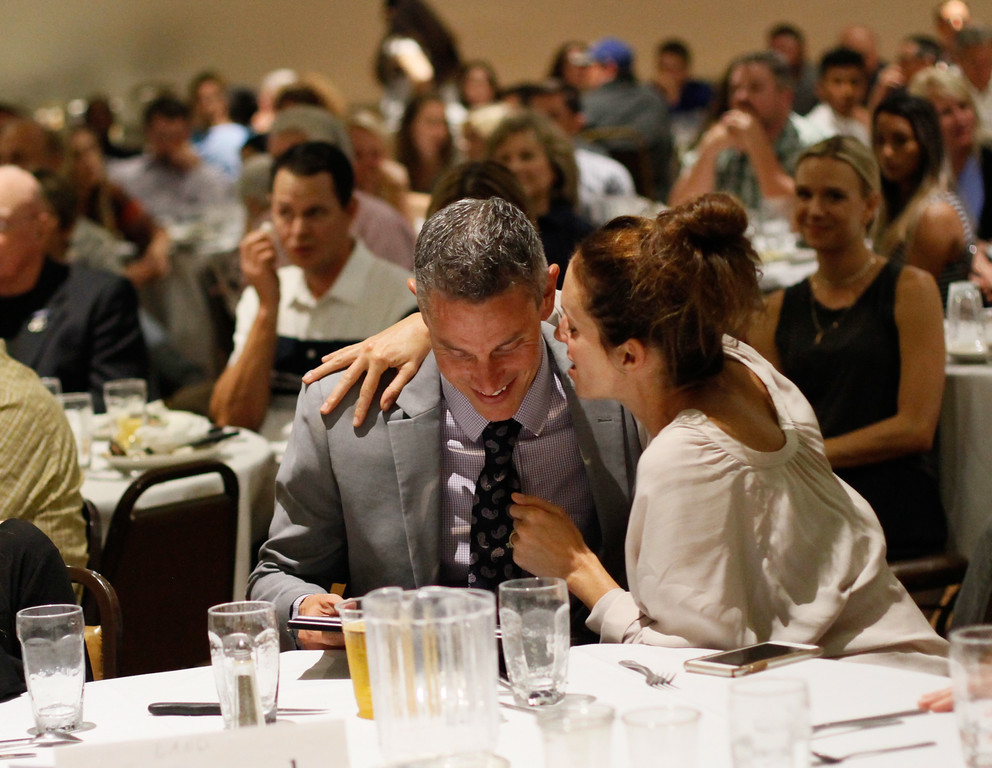 . Ross Land\'s wife congraduates him after being inducted into the Chico Sports Hall of Fame at the 45th annual Chico Sports Hall of Fame and Senior Athletes Banquet Tuesday May 9, 2017 at the Elks Lodge in Chico, California. (Emily Bertolino -- Enterprise-Record)