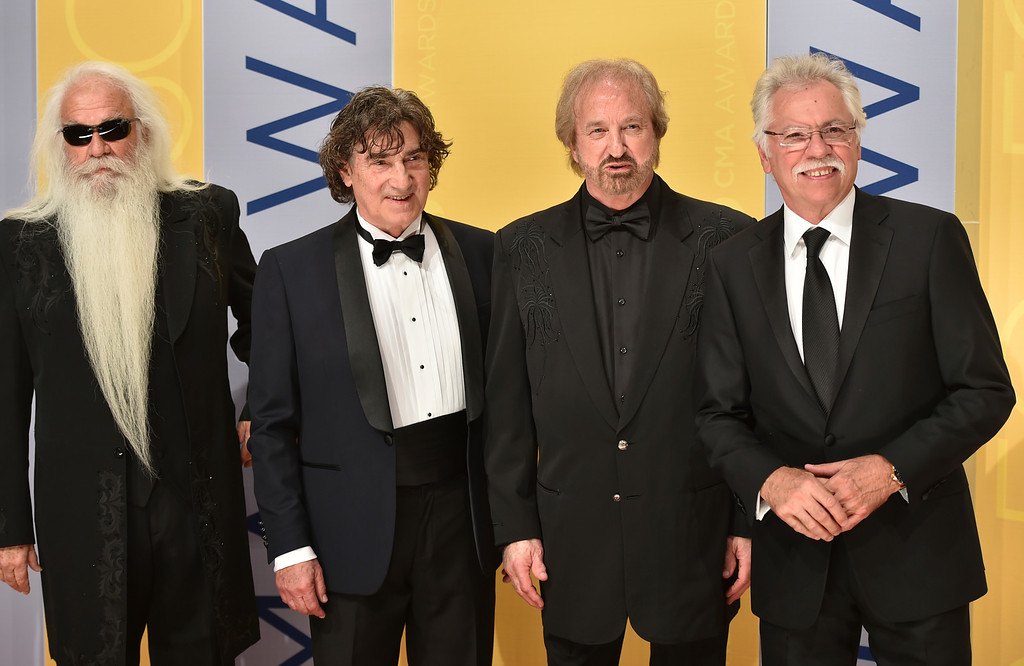 . William Lee Golden, from left, Richard Sterban, Duane Allen, and Joe Bonsall of The Oak Ridge Boys arrive at the 50th annual CMA Awards at the Bridgestone Arena on Wednesday, Nov. 2, 2016, in Nashville, Tenn. (Photo by Evan Agostini/Invision/AP)
