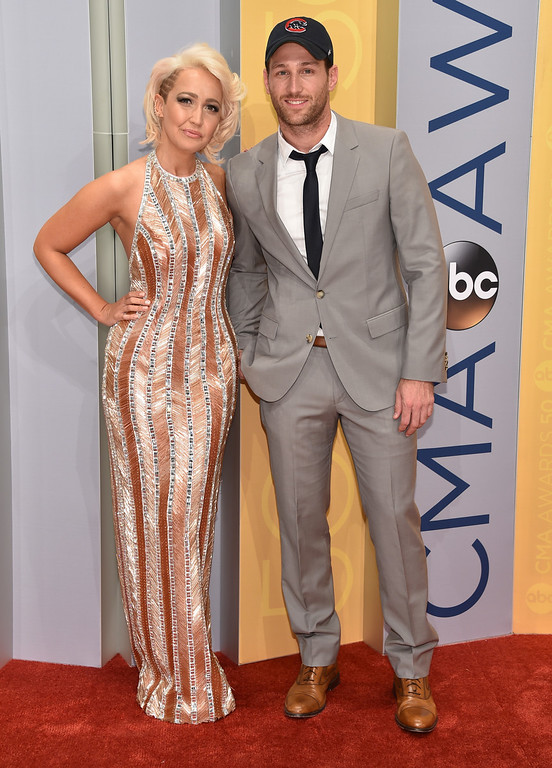 . Meghan Linsey, left, and Juan Pablo arrive at the 50th annual CMA Awards at the Bridgestone Arena on Wednesday, Nov. 2, 2016, in Nashville, Tenn. (Photo by Evan Agostini/Invision/AP)