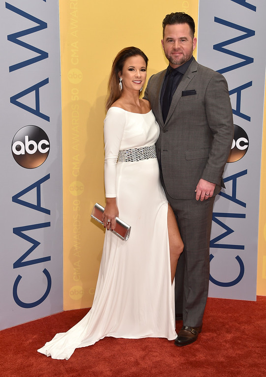 . Catherine Werne, left, and David Nail arrive at the 50th annual CMA Awards at the Bridgestone Arena on Wednesday, Nov. 2, 2016, in Nashville, Tenn. (Photo by Evan Agostini/Invision/AP)