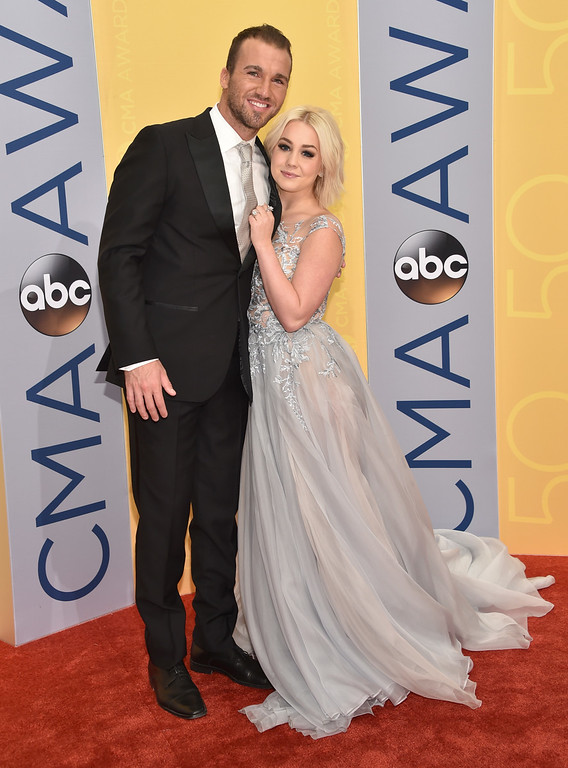 . Josh Davis, left, and RaeLynn arrive at the 50th annual CMA Awards at the Bridgestone Arena on Wednesday, Nov. 2, 2016, in Nashville, Tenn. (Photo by Evan Agostini/Invision/AP)