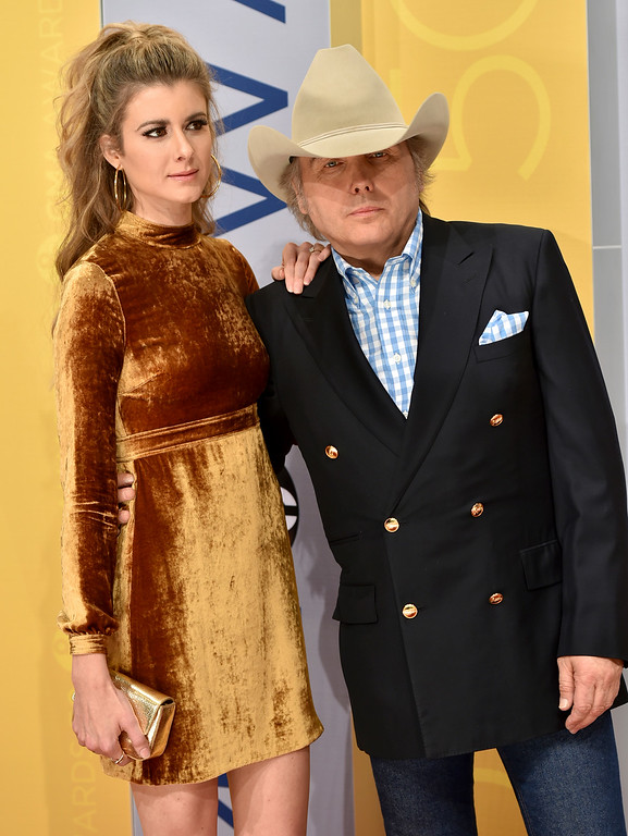 . Emily Joyce, and Dwight Yoakam arrive at the 50th annual CMA Awards at the Bridgestone Arena on Wednesday, Nov. 2, 2016, in Nashville, Tenn. (Photo by Evan Agostini/Invision/AP)