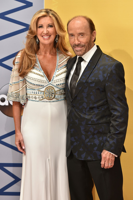 . Kimberly Payne, left, and Lee Greenwood arrive at the 50th annual CMA Awards at the Bridgestone Arena on Wednesday, Nov. 2, 2016, in Nashville, Tenn. (Photo by Evan Agostini/Invision/AP)