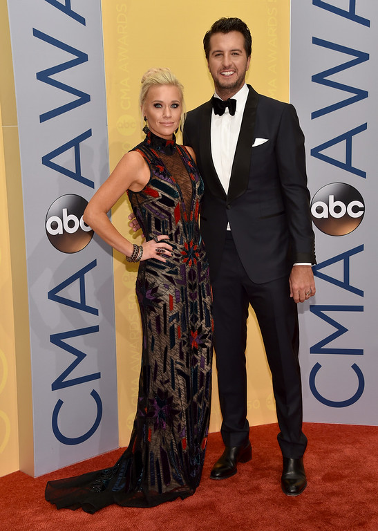 . Caroline Boyer, left, and Luke Bryan arrive at the 50th annual CMA Awards at the Bridgestone Arena on Wednesday, Nov. 2, 2016, in Nashville, Tenn. (Photo by Evan Agostini/Invision/AP)