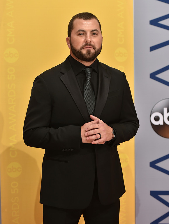 . Tyler Farr arrives at the 50th annual CMA Awards at the Bridgestone Arena on Wednesday, Nov. 2, 2016, in Nashville, Tenn. (Photo by Evan Agostini/Invision/AP)